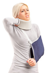 A blond woman with broken arm and injured neck suffering from a
