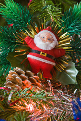 the new-year toy of Santa claus hangs on a christmas tree
