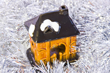 a toy house is in brilliant tinsel
