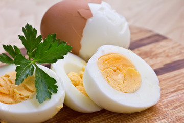 Boiled eggs on wooden board