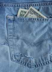 One dollars banknote in a pocket.
