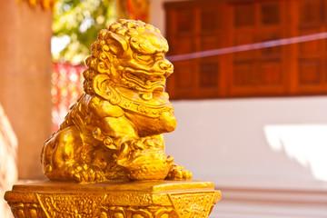 golden lion statue in thailand