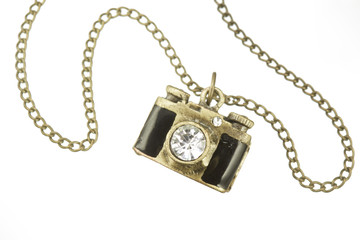 camera pendant and necklace with gem stone, over white bacground