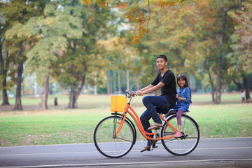 Brother and sister cycling bicycle at the park