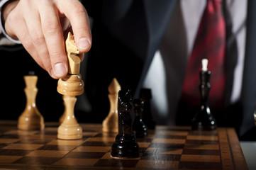 businessman plays chess