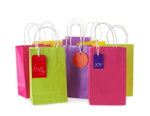Colorful shopping bags with tags