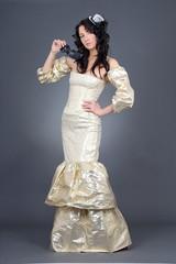 beautiful model in golden dress