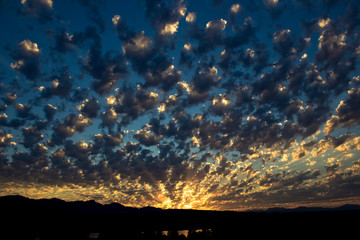 Sunset in evening with scattered clouds