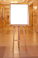 picture frame with white cut out canvas on easel