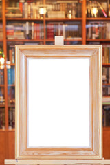 white canvas of wide picture frame on easel in library
