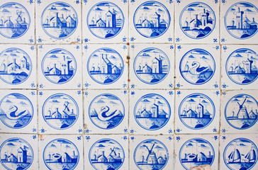 Antique dutch tiles on kitchen wall of old building