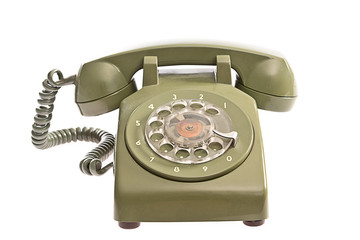 Old fashioned green telephone on white background.