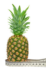 pineapple with  measuring tape on white background
