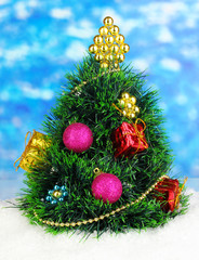 Decorated artificial Christmas Tree on bright background