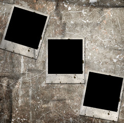 three photo frames on grunge background