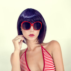 Portrait of a young girl in stylish glasses