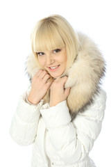 portrait of blonde girl in warm jacket with a hood