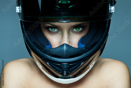 Wall mural Sexy woman in helmet on blue background