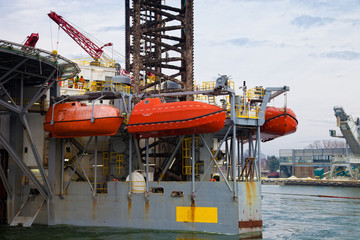 Lifeboats on an oil rig.