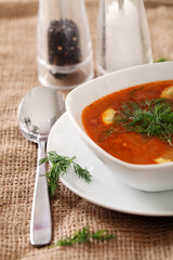 Image of bowl of hot red soup served