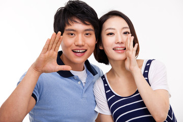 Young Asian couple say something