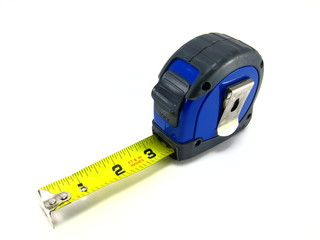 Old used blue tape measure on white background.