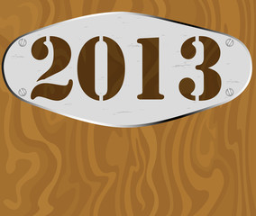 Silver sign on wooden plate with 2013 new year