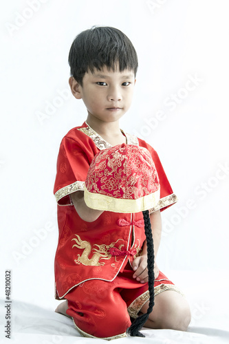 China boy in traditional chinese red tang suit greeting stock photo china boy in traditional chinese red tang suit greeting m4hsunfo