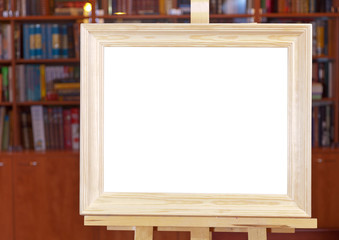 white canvas of wide wood picture frame on easel