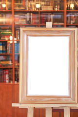 wide picture frame on easel with clipping path in home library