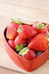 fresh strawberries in a heart shaped box