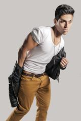 Fashion model is undresses jacket
