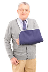 A senior man with broken arm posing