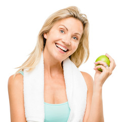 Healthy mature woman exercise green apple isolated on white back