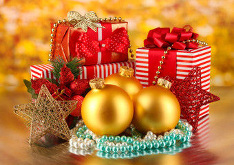 Christmas decoration and gift boxes on golden background