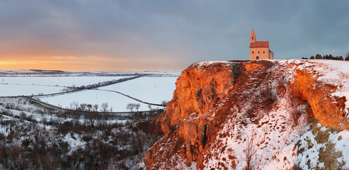 Nice Catholic Chapel in eastern Europe at winter landscape - vil