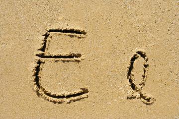 Alphabet letters E e handwritten in sand