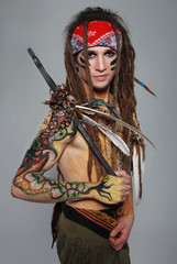 Wild musician with body art