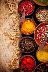 Wall Mural - Various kind of spices in wooden bowls