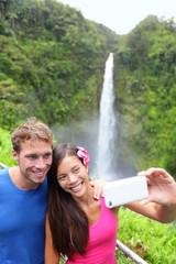 Tourists couple taking photo on Hawaii