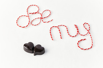 Words Be my valentine with chocolate heart