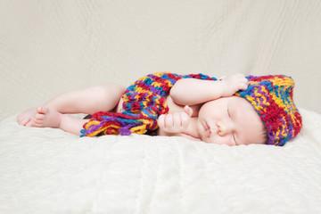 Newborn baby sleeping on a blanket