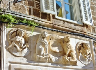 A frieze on a house in Trogir in Croatia