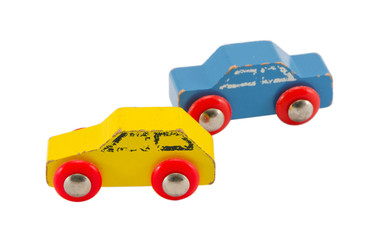 pair wooden blue yellow retro toy cars isolated