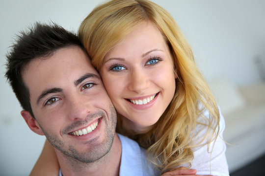 Cheerful in love couple at home