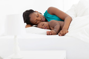 african american mother sleeping with baby boy