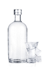 Bottle of vodka and shot glass with ice