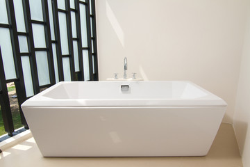 Luxury bath tub with faucet.