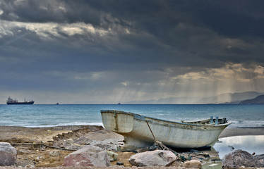 Old fishing boat after storm
