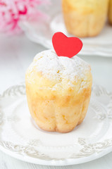Rum Baba decorated with red hearts, topped with powdered sugar